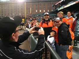 """Pete captures WBAL-AM 1090 reporter Scott Wykoff (""""a man with the people"""") taking pictures for fans."""
