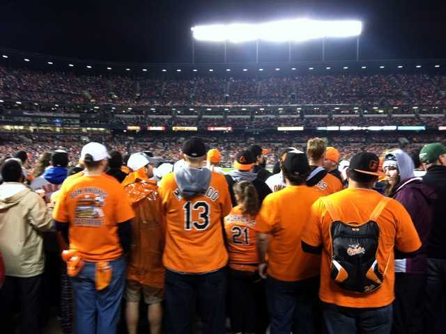 Even these fans couldn't be happier to be standing five-rows deep to see their beloved O's play in the postseason.