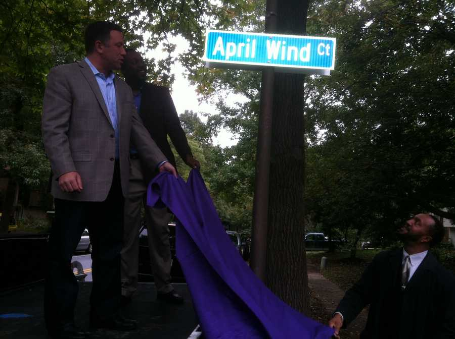 Howard County officials and residents in the Oakland Mills Village of Columbia gathered Monday for the unveiling of a street name change from Coon Hunt Court to April Wind Court.
