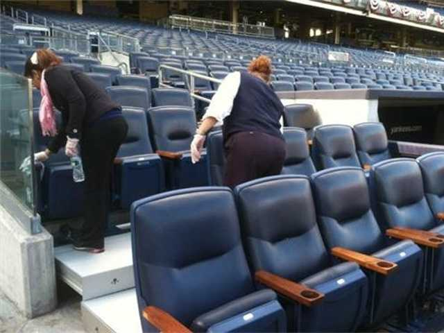 Crews prepare Yankee Stadium before Game 3 of the ALDS.