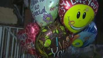 Balloons and toys were placed at the home in memory of the four children who died.
