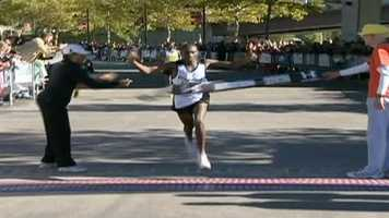 Stephen Muange finishes first in the men's marathon.