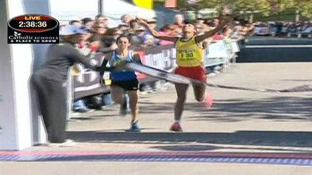 Elfneshe Yado and Malika Mejdoub finish 2:38:46, merely an inch apart in the women's marathon finish.