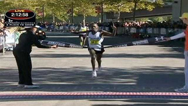 Stephen Muange, of Keyna, shaves better than two minutes off his first-place finish last year, defending his crown in the Baltimore Marathon.