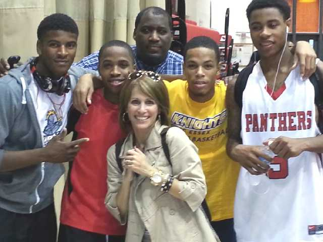 (From left to right) Bobby Mack, Leon Fleming, Coach William Russell, Jesse Barr, and Antoine Montgomery. WBAL-TV 11's Deborah Weiner at center.