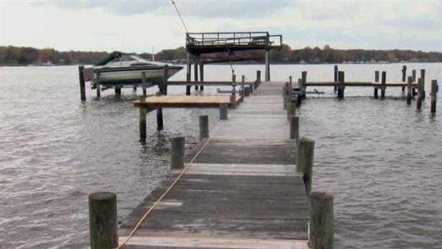Marylanders who live on the water prepare their property for Hurricane Sandy.