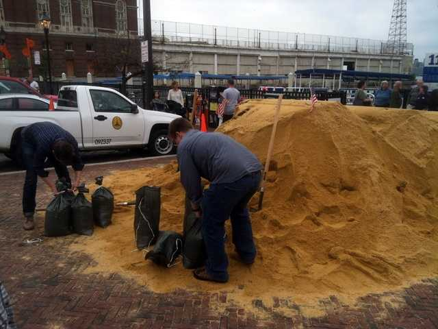 Tons of sand arrived Friday in Fells Point for Baltimore City residents to collect to protect their homes.