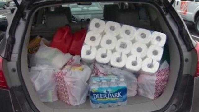 Marylanders rush stores to stock up on supplies ahead of Hurricane Sandy.