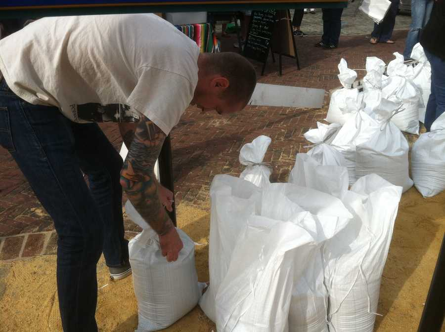 Baltimore City residents get another day to collect sand and bags to secure their homes in low-lying and flood-prone areas.
