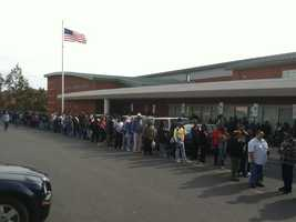 Voters stand two hours to get inside the Randallstown Community Center to cast their votes.