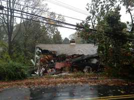 A tree fell into a home in Linthicum, destroying parts of the structure.