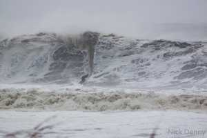 Surfer Todd Elder takes to the massive waves that were churned up by Hurricane Sandy in Ocean City.