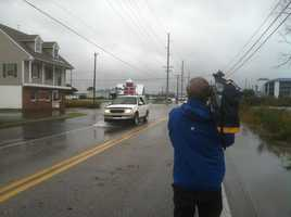 Photographer Chuck Cochran filming in Kent Island on Tuesday morning.