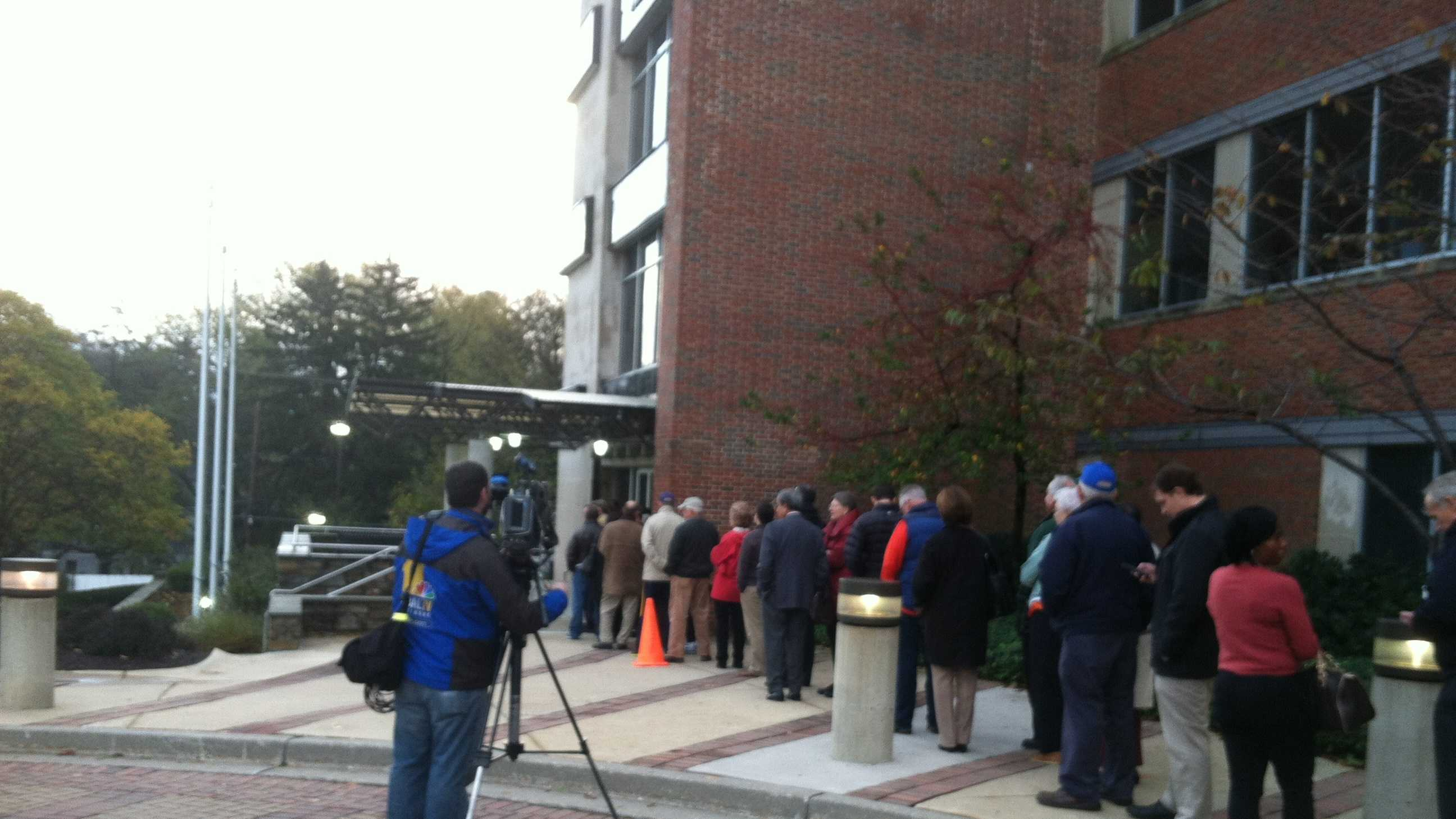 People line up Wednesday morning as early voting resumes after Hurricane Sandy.