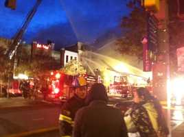 A four-alarm fire in Baltimore's popular Fells Point neighborhood keeps firefighters busy early Tuesday morning.