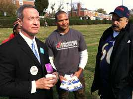 Gov. Martin O'Malley, with Ravens linebacker Brendon Ayanbadejo and Baltimore City Delegate Curt Anderson, D-District 43, distributes literature for Question 6 at Northwood Elementary School in northeast Baltimore.