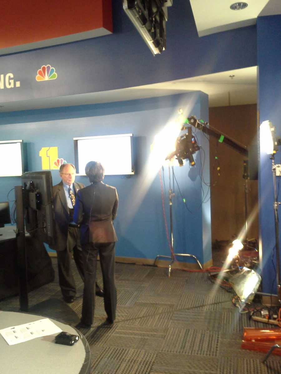I-Team Lead Investigative Reporter Jayne Miller speaks withUMBC Public Policy Professor Don Norris in the WBAL-TV newsroom.