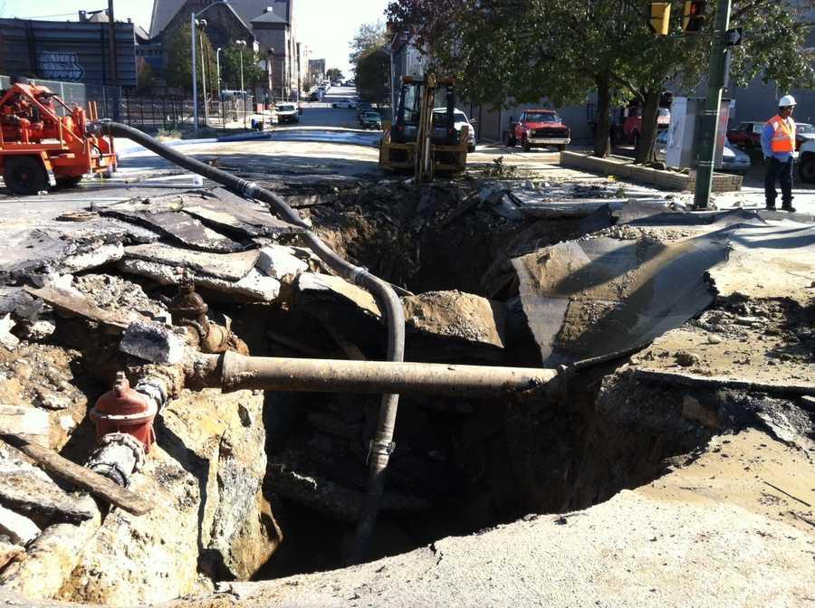 On Friday, crews work to repair the60-inch water main break in Baltimore.