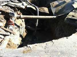 On Friday, crews work to repair the 60-inch water main break in Baltimore.