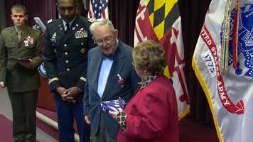 A military official announced during the ceremony that Rath's honors stem from April 1, 1945, when he and others served in support of the Blood and Fire divisions' drive through central Europe.
