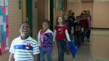 Students headed to the cafeteria to wait for their guest. Little did they know that Staff Sgt. Tim Ott would read to them from 6,000 miles away in Afghanistan.