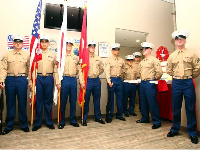 Marines in the color guard show their patience as they wait to participate in a cake-cutting ceremony.