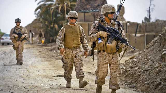 Marines patrol with Afghan police.