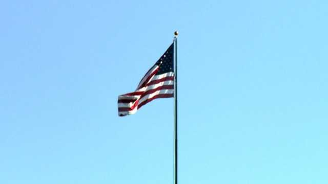 This year, on Veterans Day, the flag triumphantly returns.