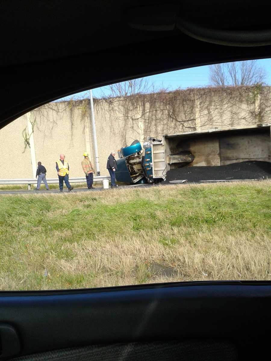 An overturned dump truck carrying asphalt on Interstate 83 ties up traffic on the north side of the Beltway Monday afternoon.