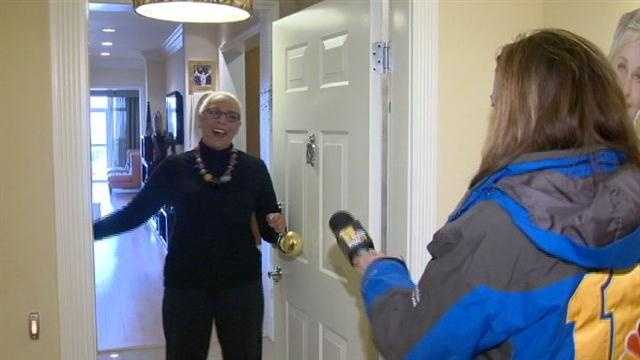 Baltimore resident Trena Brown is surprised by 11 News reporter Jennifer Franciotti with news that she's 1 of 10 grand prize winners who will get to go to one of the Ellen Show's 12 Days of Giveaways tapings.