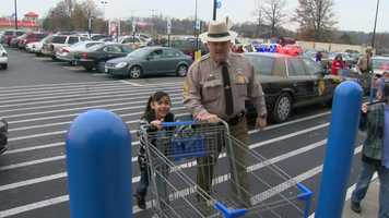 It was a day to Shop with a Cop, an annual event that brings the holidays to area families in need.