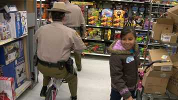 It was a special day for the troopers, too, one who tried out a bike in the aisle.