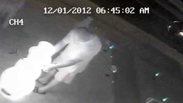 Surveillance video shows a man removing arms from Frosty the Snowman.