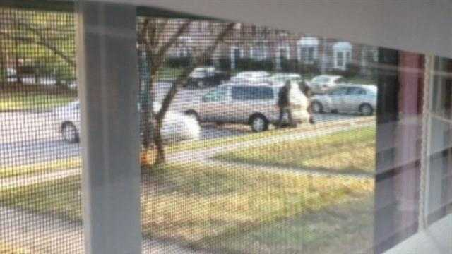 Neighbor Jocie Hagen snaps photos of the suspicious men in their gold van.