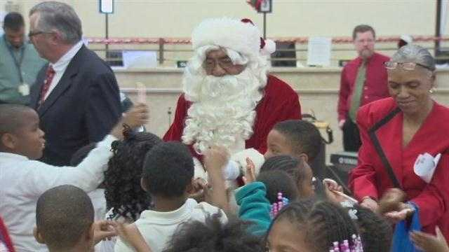 Local children got to meet Santa at the Mitten Tree kickoff event.