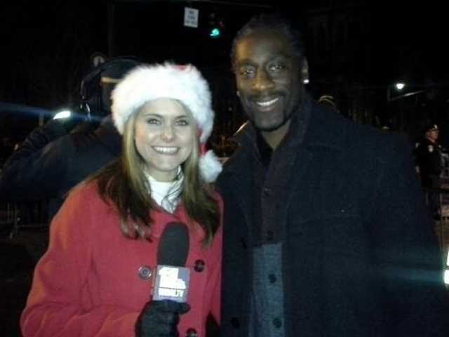 This year's celebrity monument lighter, Ravens cornerback Lardarius Webb, with 11 Insta-Weather PLUS meteorologist Ava Marie.