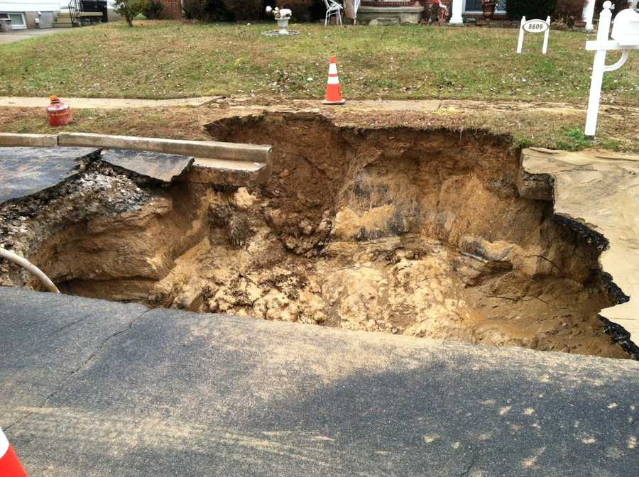 Department of Public Works crews are called to a water main break that caused a sinkhole in Randallstown. Water service was shut off to some 60 homes.