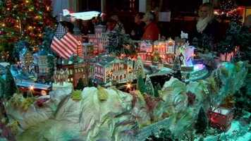The 24x10 foot display features coal locomotives, switch tracks, flashing train signals and plenty to see in the village, including a carnival with electronic rides.