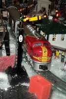 There are 4 continuously operating trains going over and under each other that are switched out with different model over the season. Over 40 houses and 75 lampposts are illuminated.