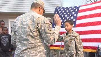 """""""It's come to my attention that one of your lifelong ambitions is to become a soldier, so I brought some of my troops here to make you an honorary member of the United States Army,"""" Capt. Barndon Crawford told the boy."""