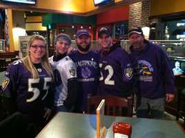 Some of the first Ravens fans to arrive for the kickoff to the Purple Caravan at The Greene Turtle along McHenry Row in Locust Point.