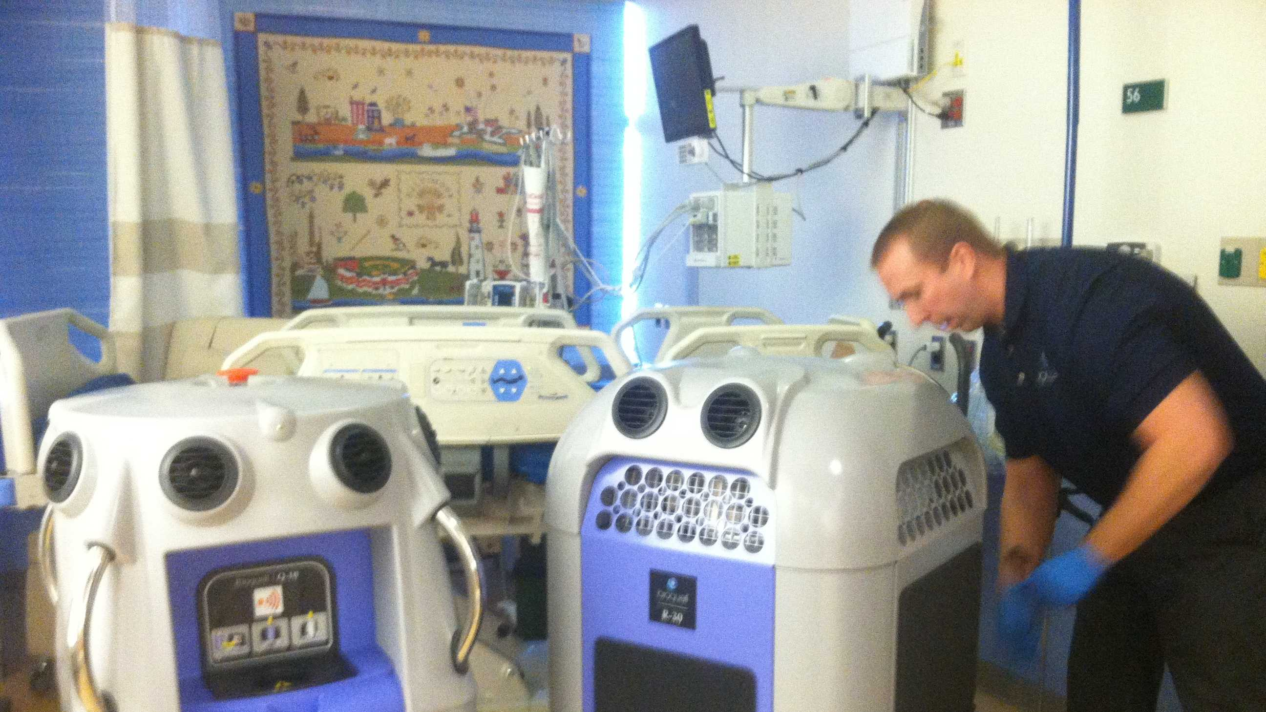 A technician sets up the Bioquell Q10 robots for the cleaning.