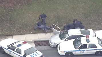 At some point, it appears one of the officers was injured and was being helped by fellow officers.