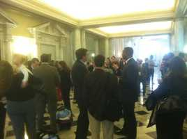 The State House hallway is full of delegates, senators and aides.