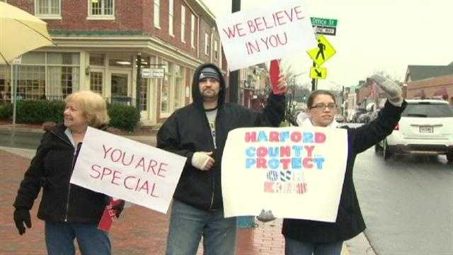 Supporters of a Bel Air teenager accused of killing his father rally on his behalf as the teen heads into the Harford County Courthouse for a pre-trial hearing.