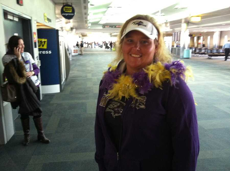 A fan gets ready to board the flight to Providence for the AFC title game between the Baltimore Ravens and the New England Patriots.WBAL-TV/Scott Wykoff