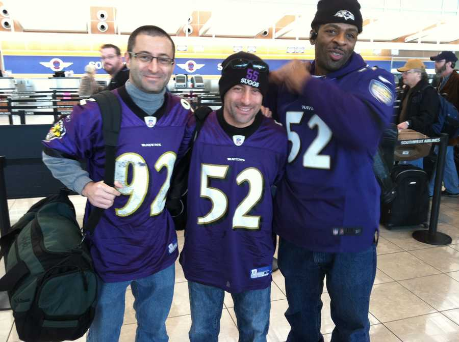 Three friends arrive at BWI to board their flight to Providence as they head to Gillette Stadium in Foxboro for the AFC Championship Game.WBAL-TV/Scott Wykoff