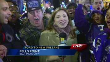 Ravens fans in Federal Hill celebrate the team's success as they head to the Super Bowl.