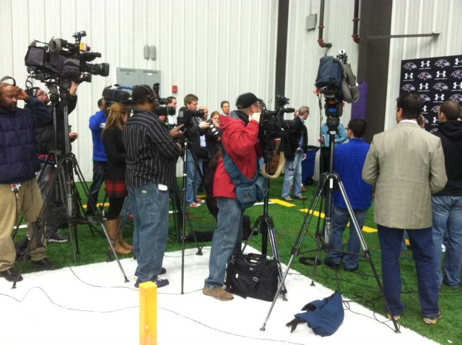 The media gathers in Owings Mills for a Ravens press conference.
