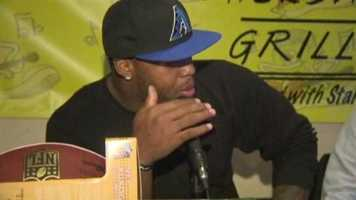 Ravens linebacker Terrell Suggs greets fans at Hightopps Backstage Grille in Timonium. Read the story.
